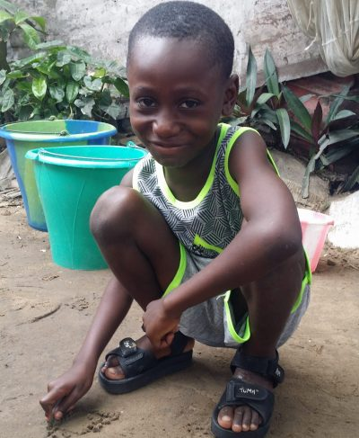 Meet Célé - He is 8 years old, he loves learning how to speak French and hopes to become a driver one day. Click Célé's picture to sponsor him!