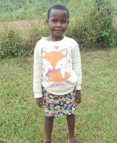 Meet Malwande - She is 7 years old, she loves running and hopes to become a teacher one day. Click Malwande's picture to sponsor her!