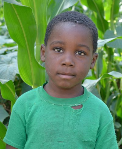 Meet Moshi - He is 8 years old, he loves playing and hopes to become a policeman one day. Click Moshi's picture to sponsor him!