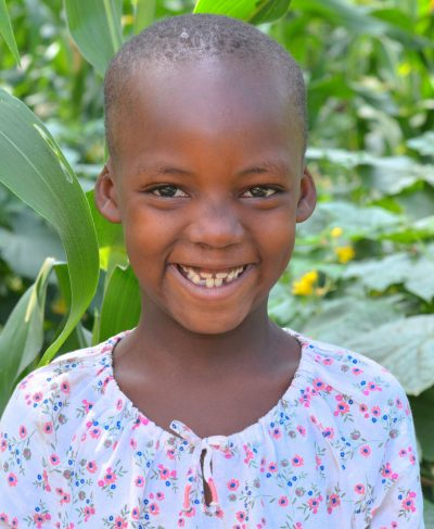 Click Grace's picture to sponsor her - She is 6 years old, loves singing and hopes to become a teacher one day!