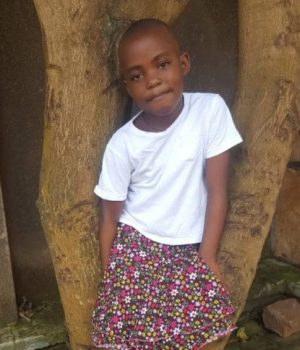 Click Regina's picture to sponsor her - She is 6 years old and wants to become a teacher someday.