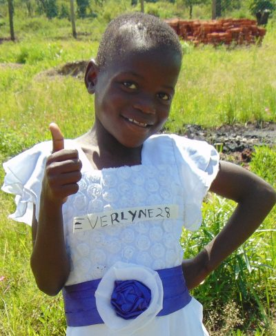 Meet Everlyne - She is 9 years old, she loves playing with her friends and hopes to become a doctor one day. Click Everlyne's picture to sponsor her!