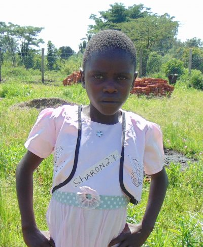 Meet Sharon - She is 9 years old, she loves nature because it is beautiful and hopes to become a teacher one day. Click Sharon's picture to sponsor her!