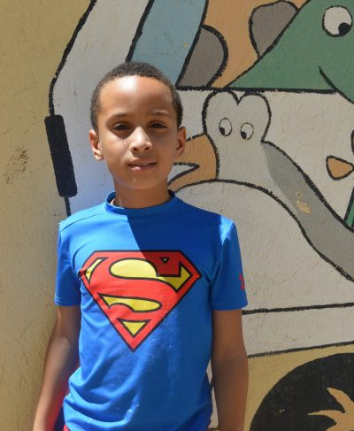 Click Richard's picture to sponsor him - He is 10 years old, loves to play with his friends and wants to be a train driver one day!