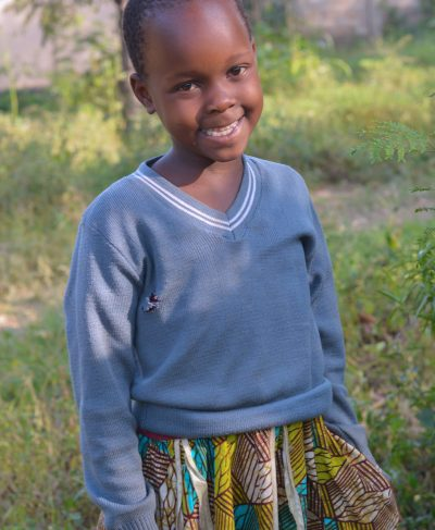 Click Jesca's picture to sponsor her - She is 6 years old, loves to study writing and hopes to become a doctor one day.