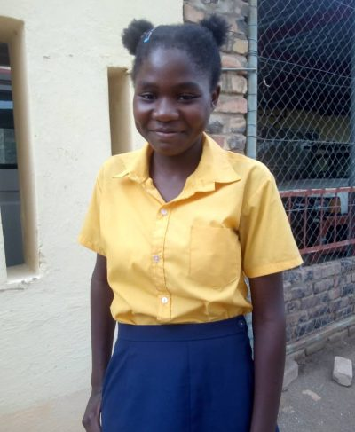Click Queen's picture to sponsor her - She is 16 years old, loves sports and wants to be a scientist one day.