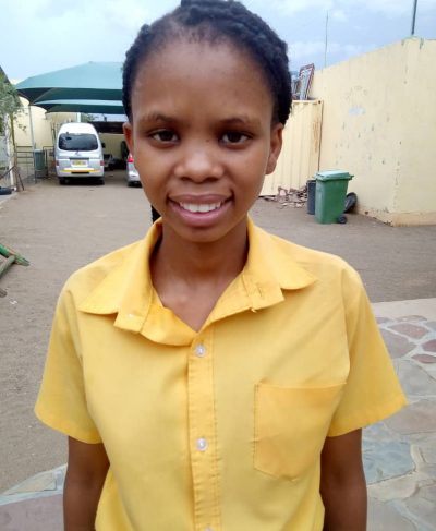 Click Getruida's picture to sponsor her - She is 16 years old, loves to learn and hopes to become a musician one day.