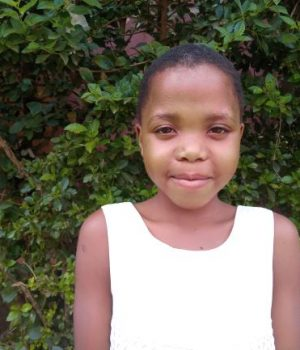 Click Denise's picture to sponsor her - She is 9 years old, loves to play, and wants to be a lawyer.