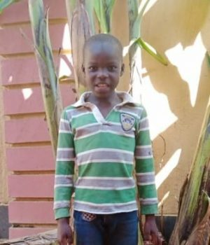 Click Mark's picture to sponsor him - He is 8 years old, loves math, and wants to be a pilot.