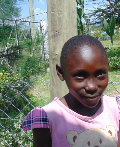 Click Quinter's picture to sponsor her - She is 8 years old, loves singing and wants to be a teacher.