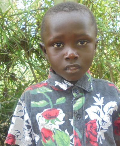 Click Lordrick's picture to sponsor him - He loves playing with his friends and wants to be a doctor.