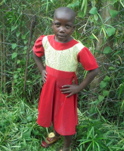 Click Mildred's picture to sponsor her - She is 6 years old, loves reading and wants to be a local administrator.