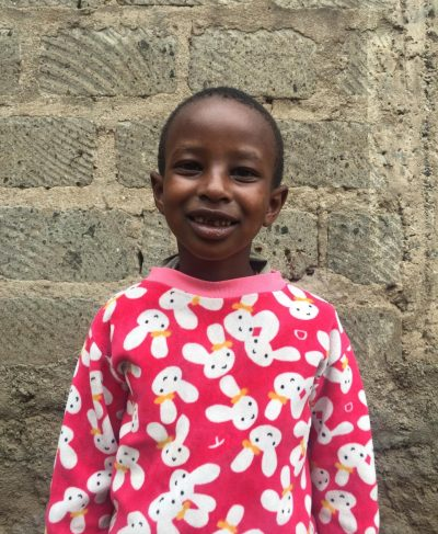 Click David's picture to sponsor him - He is 7 years old, loves to read and wants to be a doctor.