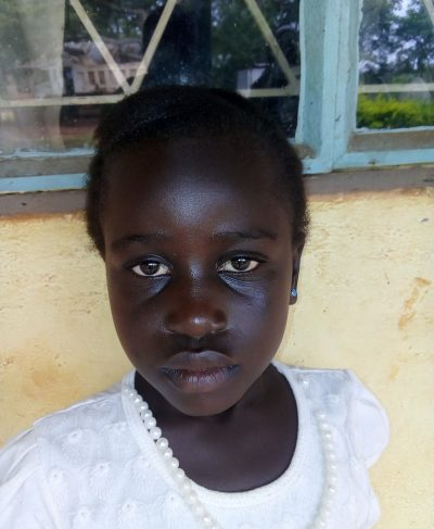 Click Everline's picture to sponsor her - She is 7 years old, loves reading and wants to be a doctor.