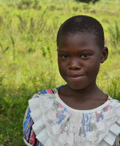 Click Milca's picture to sponsor her - She is 10 years old, loves school, and wants to be a nurse.