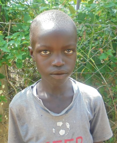 Click Fedinant's picture to sponsor her - She is 8 years old, loves reading, and wants to be a doctor.