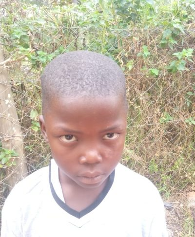 Click Alphonce's picture to sponsor her - She is 7 years old, loves school, and wants to be a driver.