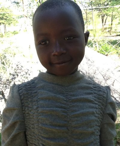 Click Benter's picture to sponsor her - She is 8 years old, loves school, and wants to be a teacher.