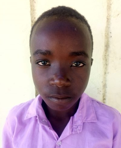 Click Domnic's picture to sponsor him - He is 11 years old, loves English, and wants to be a driver.