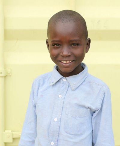 Click Fredrick's picture to sponsor him - He is 8 years old, loves reading, and wants to be a pilot.
