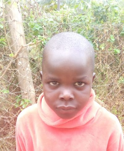 Click Isaac's picture to sponsor him - He is 8 years old, loves math, and wants to be a pilot.
