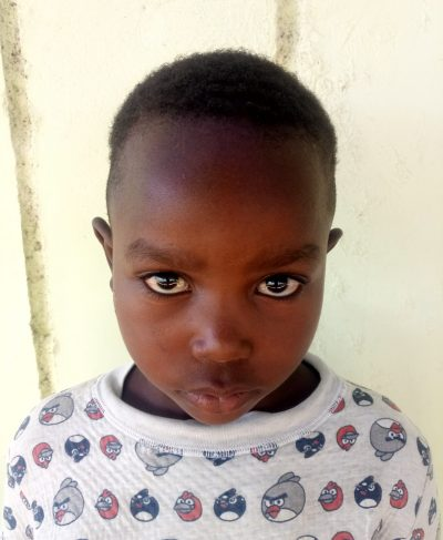 Click Karim's picture to sponsor him - He is 6 years old, loves English, and wants to be a police officer.