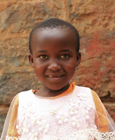 Click Sharon's picture to sponsor her - She is 9 years old, loves learning, and wants to be a pilot.