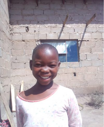 Click Tandzisile's picture to sponsor her - She is 11 years old, loves English, and wants to be a nurse.