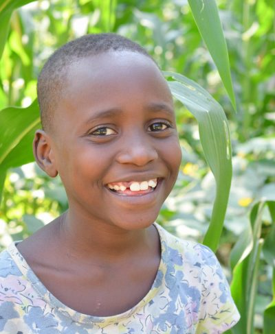 Click Lucia's picture to sponsor her - She is 9 years old, loves math, and wants to be a teacher.
