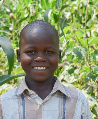 Click Pius's picture to sponsor him - He is 9 years old, loves math, and wants to be a police man.