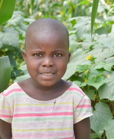 Click Nasra's picture to sponsor her - She is 8 years old, loves numbers, and wants to be a police officer.