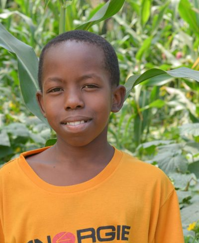 Click Joshua's picture to sponsor him - He is 10 years old, loves playing games, and wants to be a president.