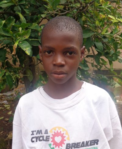 Click Nuru's picture to sponsor him - He is 12 years old, loves reading, and wants to be a teacher.