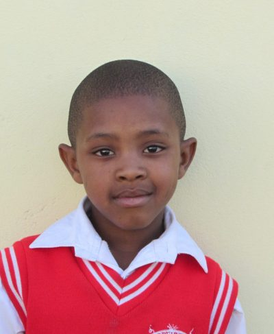 Click Remano's picture to sponsor him - He is 10 years old, loves science, and wants to be a police man.