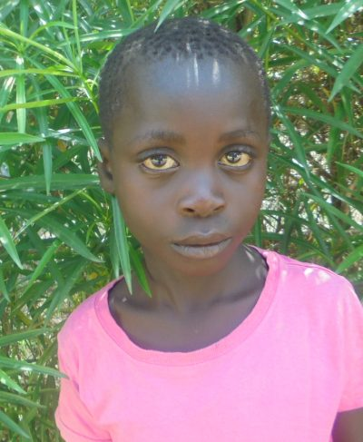 Click John's picture to sponsor him - He is 8 years old, loves math, and wants to be a driver.