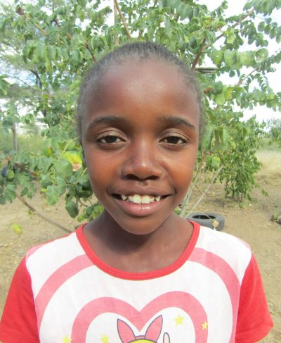 Click Eunike's picture to sponsor her - She is 11 years old, loves reading, and wants to be a doctor.
