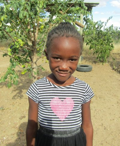 Click Dezi's picture to sponsor her - She is 7 years old, loves art, and wants to be a teacher.