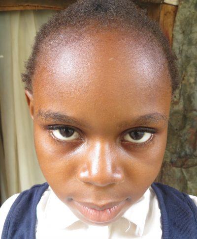 Click Lycie's picture to sponsor her - She is 9 years old, loves to play, and wants to be a policewoman.