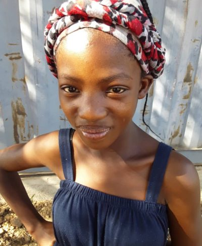 Click Wilhelmina 's picture to sponsor her - She is 14 years old, loves to learn, and wants to be a police officer.