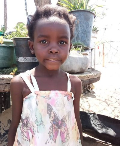 Click Rejoice's picture to sponsor her - She is 8 years old, loves to play, and wants to be a teacher.
