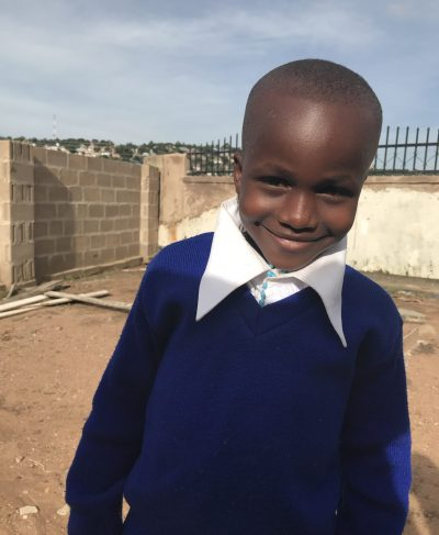 Click Yohana's picture to sponsor him - He is 8 years old, loves math, and wants to be a doctor.